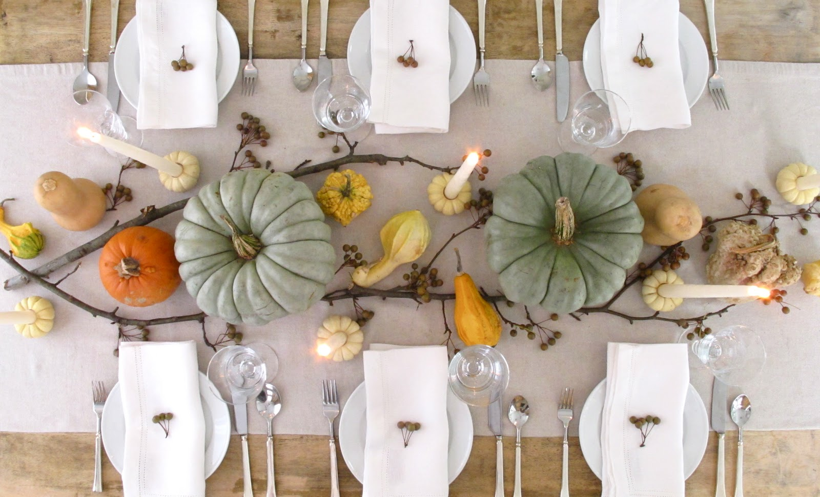 personable-diningroom-decorating-ideas-white-table-skirting-and-pumpkins-centerpieces-white-plates-and-white-napkins-clear-glasses-and-spoons-also-forks-di